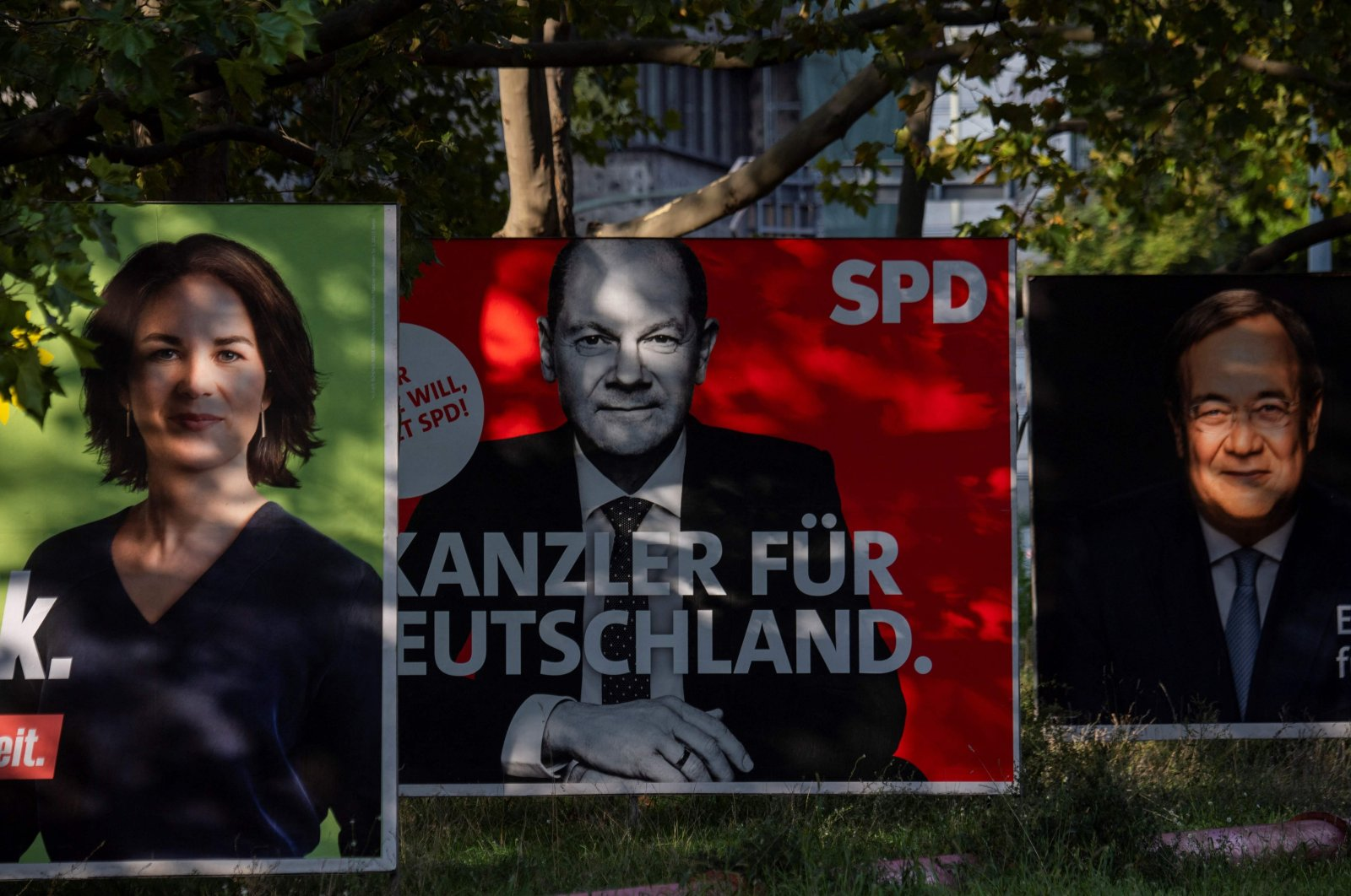 Billboards with election campaign posters showing the three chancellor candidates in the Sept. 26 federal election, (L-R) co-leader of Germany's Greens (Die Gruenen) Annalena Baerbock, German Finance Minister and Vice-Chancellor of the Social Democratic SPD Party Olaf Scholz and Christian Democratic Union CDU leader Armin Laschet are seen in Berlin, Germany, Sept. 25, 2021. (AFP Photo)