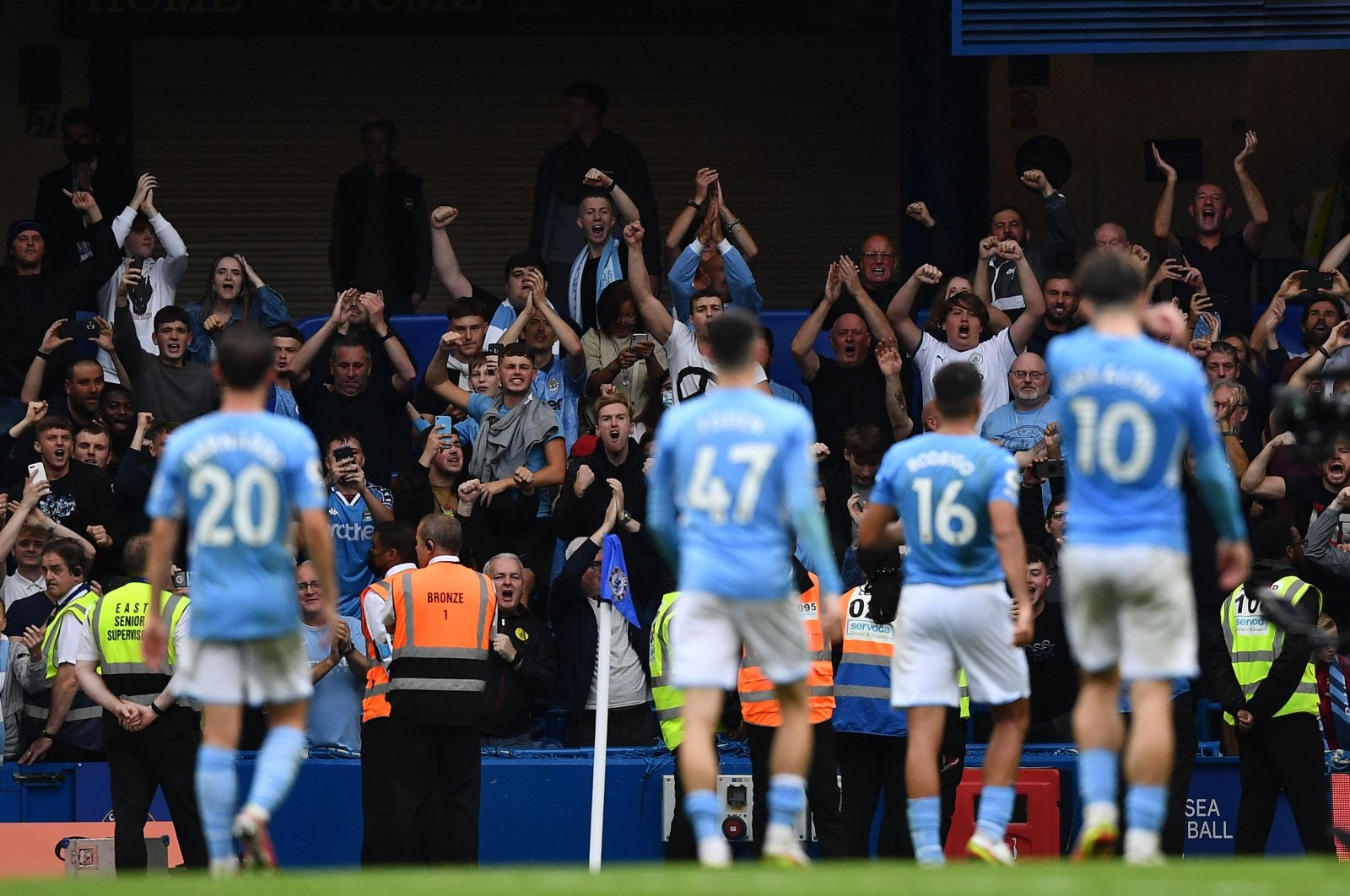 Manchester City's fans react at the final whistle during the English Premier League football match between Chelsea and Manchester City at Stamford Bridge in London on Sept. 25, 2021. (AFP Photo)