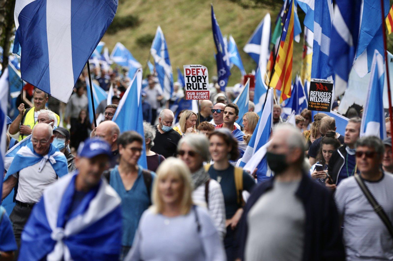 Demonstrators demanding new independence vote march to Scottish Parliament, Edinburgh, Sept. 25, 2021. (AA Photo)