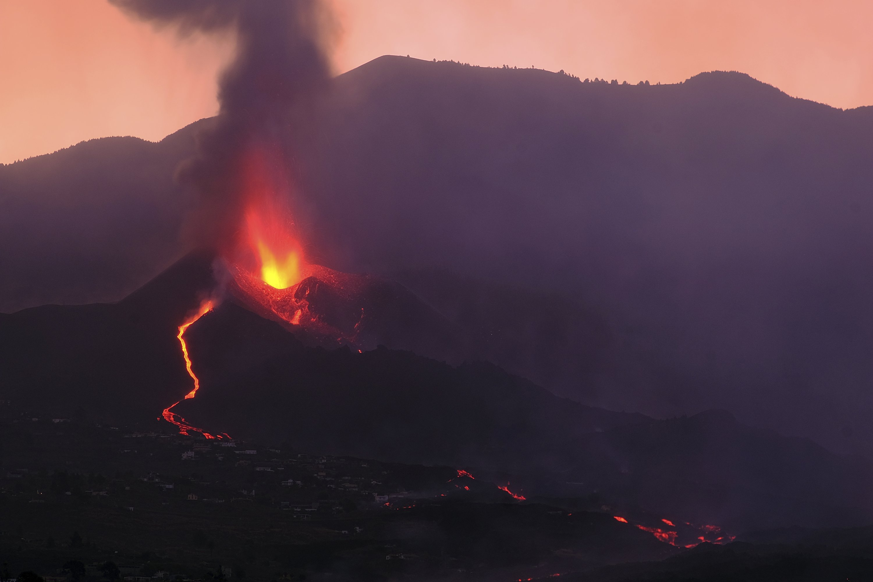 Lava flows from a volcano on the Canary island of La Palma, Spain in the early hours of Sunday, Sept. 26, 2021. (AP Photo)