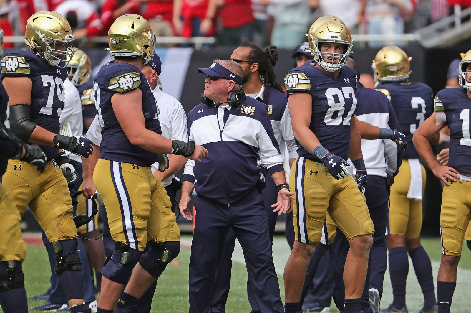 Notre Dame head coach Brian Kelly (C) talks to members of his team after a turnover against the Wisconsin Badgers at Soldier Field, Chicago, Illinois, U.S., Sept. 25, 2021. (AFP Photo)