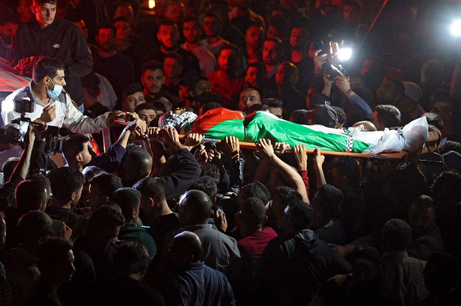 Mourners carry the body of Mohammed Khabisa, a Palestinian who was shot dead by Israeli troops, during his funeral in the village of Beita, the occupied West Bank, Palestine, Sept. 24, 2021. (AFP Photo)
