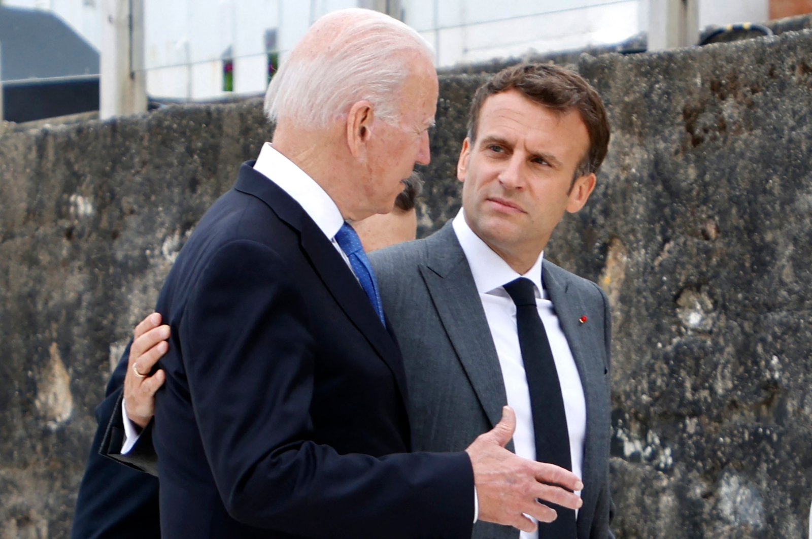 U.S. President Joe Biden (L) and French President Emmanuel Macron speak after the family photo at the start of the G-7 summit in Carbis Bay, Cornwall, Britain, June 11, 2021. (AFP Photo)