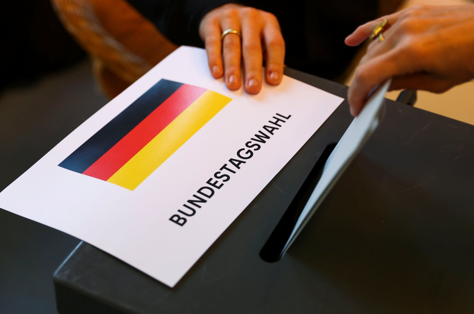 A person casts their vote for the general elections in Berlin, Germany, Sept. 26, 2021. (Reuters Photo)