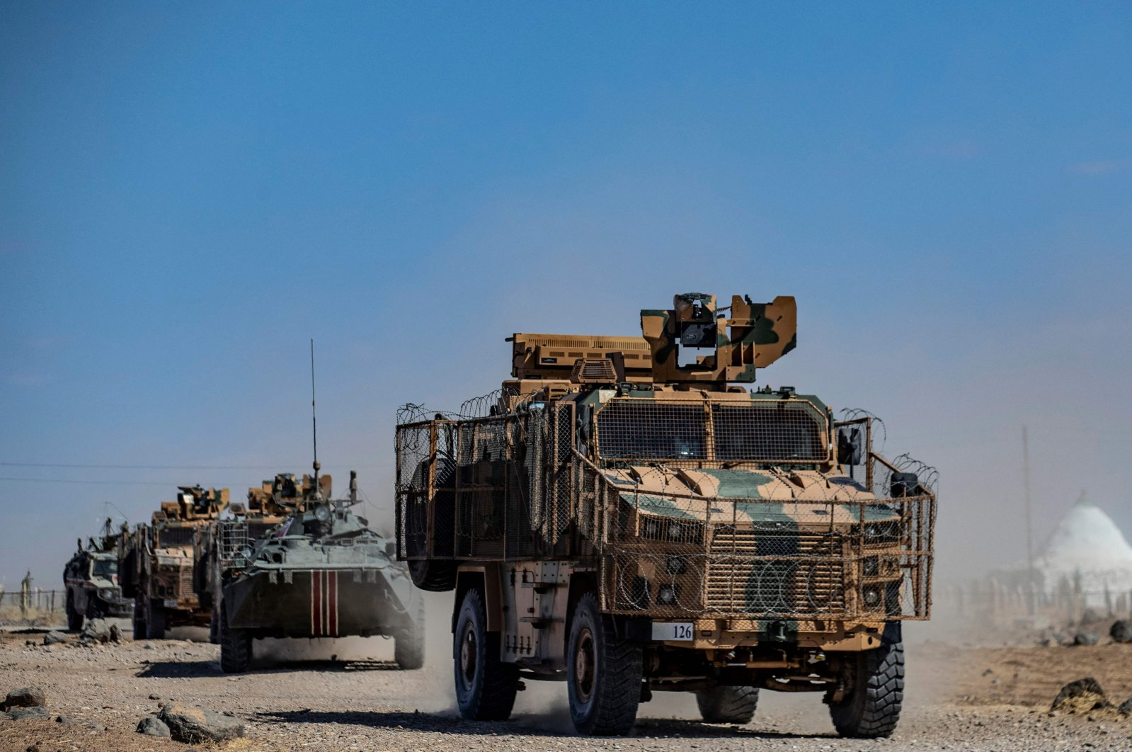 Turkish and Russian military vehicles patrol in the countryside of Rumaylan (Rmeilan) in Syria's northeastern Hasakeh on Sept. 16, 2021. (AFP Photo)