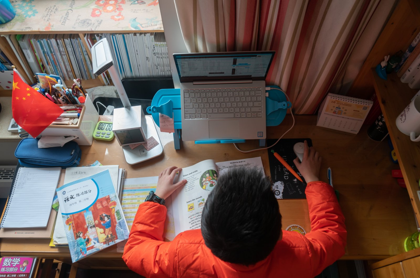 A primary school student takes classes online, studying from home, Shanghai, China, March 3, 2020. (Reuters Photo)