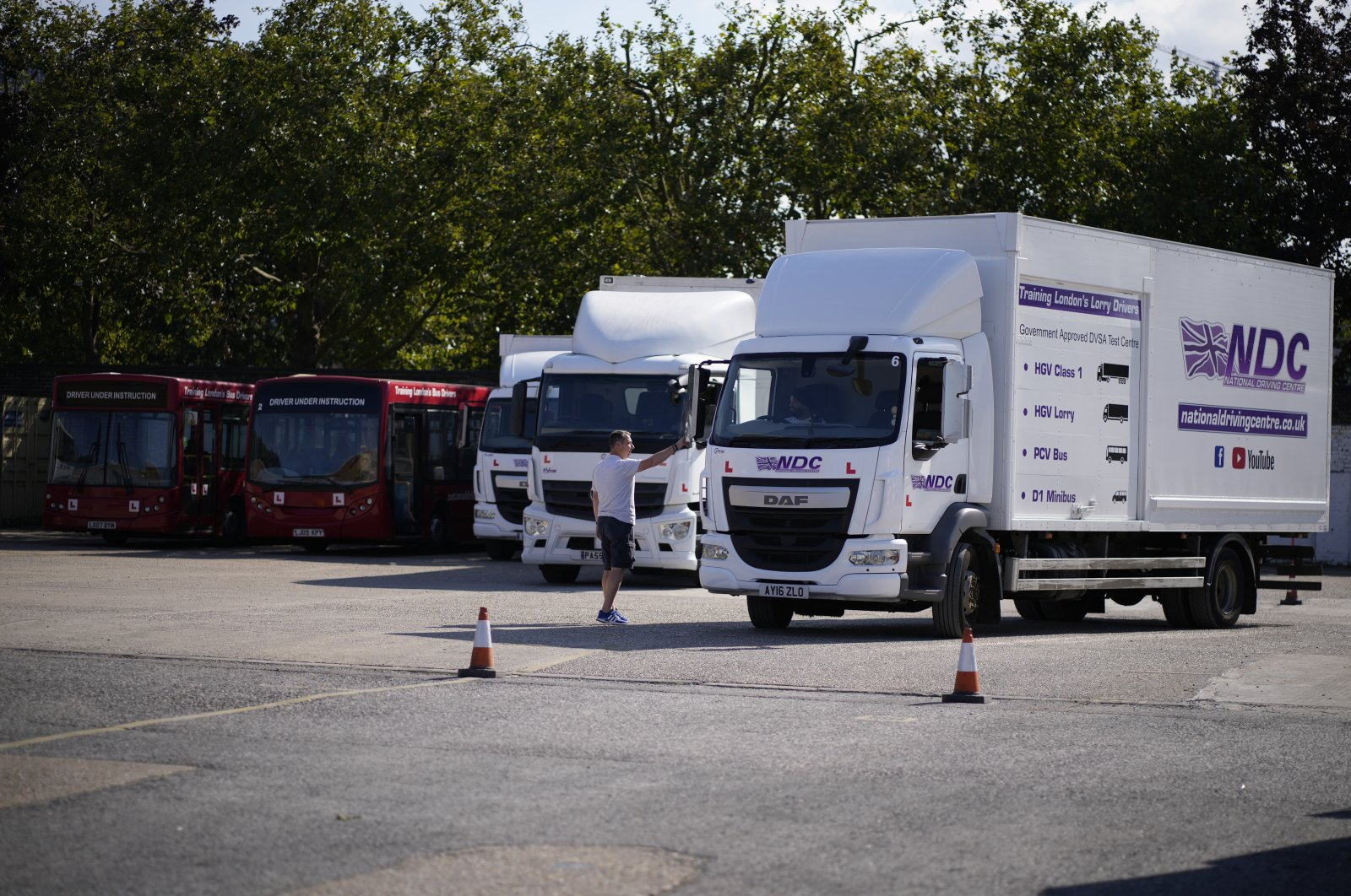 An instructor directs a learner truck driver at the National Driving Centre in Croydon, south London, U.K., Sept. 22, 2021. (AP Photo)