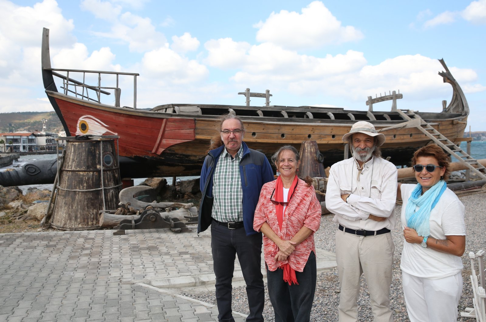 Members of the group pose in front of Kybele, a replica of an ancient boat they constructed, in Izmir, western Turkey, Sept. 25, 2021. (AA PHOTO)