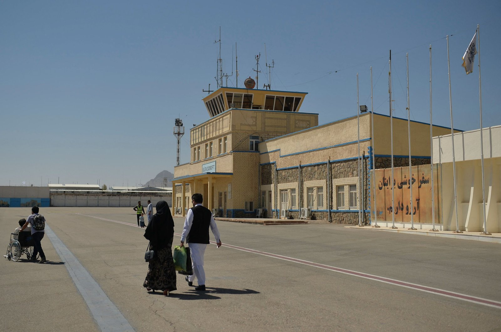 Passengers walk on the tarmac to board a commercial aircraft bound for Kabul at Herat airport, Afghanistan, Sept. 22, 2021. (AFP Photo)