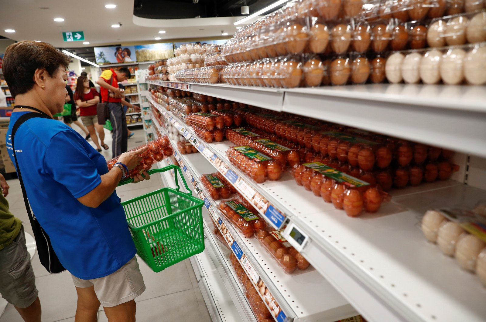 People buy eggs at a supermarket in Singapore, March 17, 2020. (Reuters Photo)