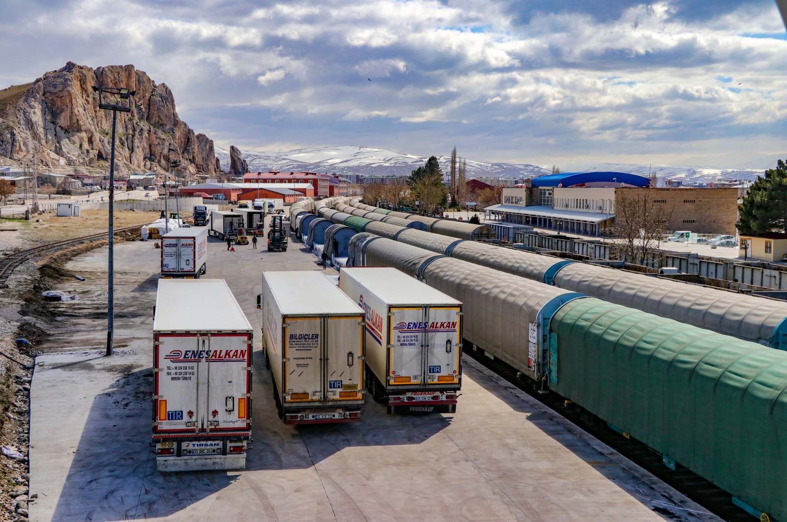 Trucks carrying goods and railway cars are seen near a logistics center in the eastern province of Van near the Iranian border, March 23, 2020. (AA Photo)