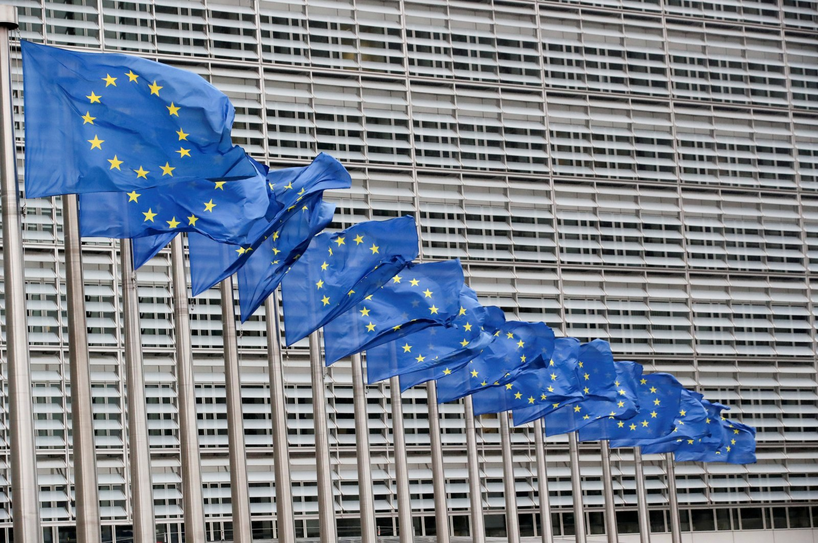 European Union flags flutter outside the EU Commission headquarters in Brussels, Belgium, July 14, 2021. (REUTERS Photo)