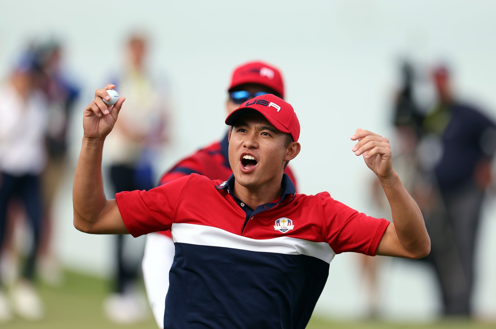 United State's Collin Morikawa celebrates on the 17th green after winning the hole to go 1up and guarantee the half point needed for the U.S. to win during Sunday Singles Matches of the 43rd Ryder Cup at Whistling Straits, in Kohler, Wisconsin, Sept. 26, 2021.