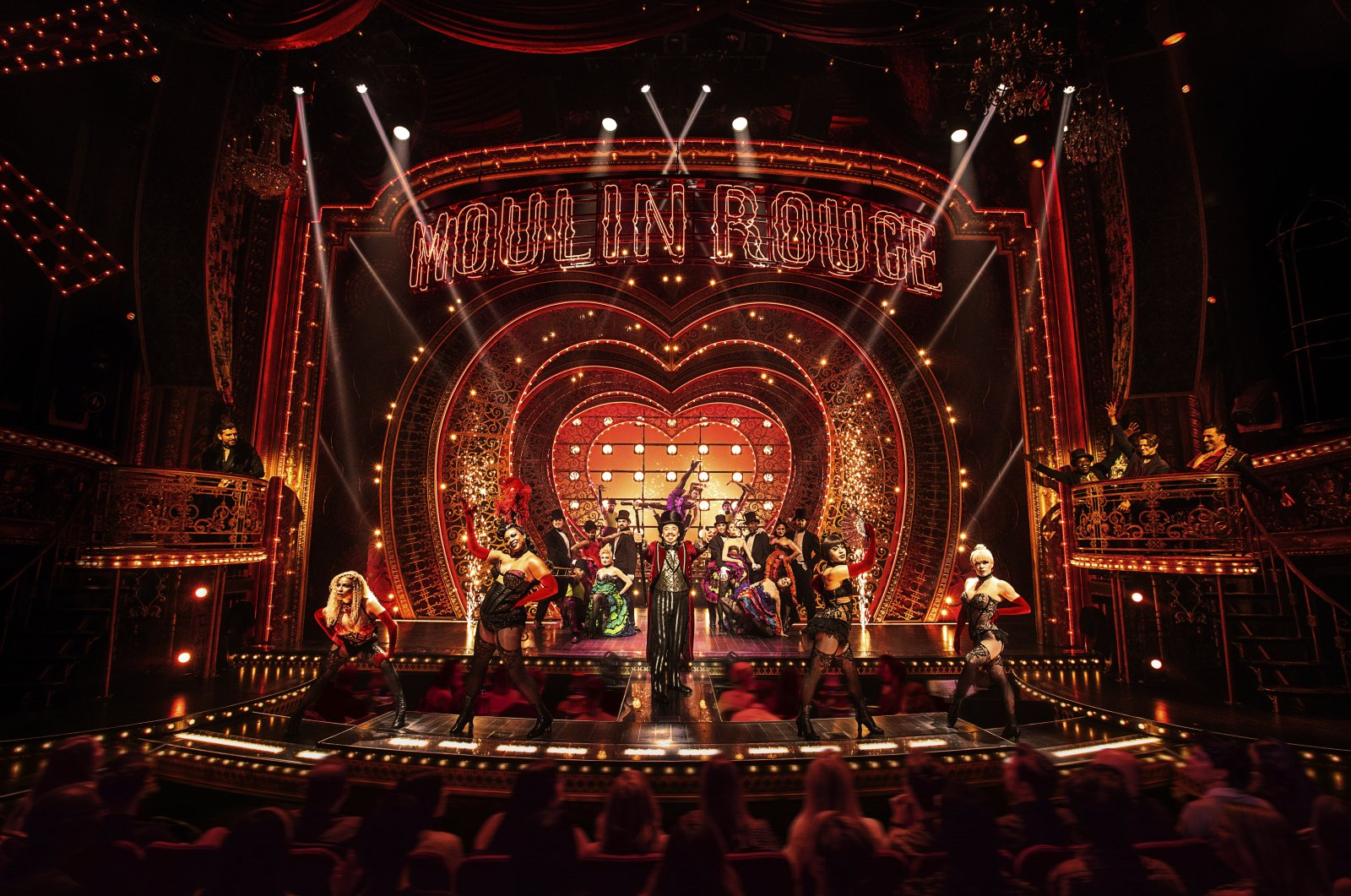 """This image released by Boneau/Bryan-Brown shows the cast in """"Moulin Rouge! The Musical."""" (AP)"""