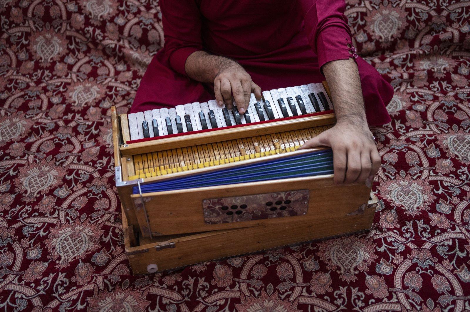 An Afghan musician plays the harmonium in Kabul, Afghanistan, Thursday, Sept. 16, 2021. (AP)