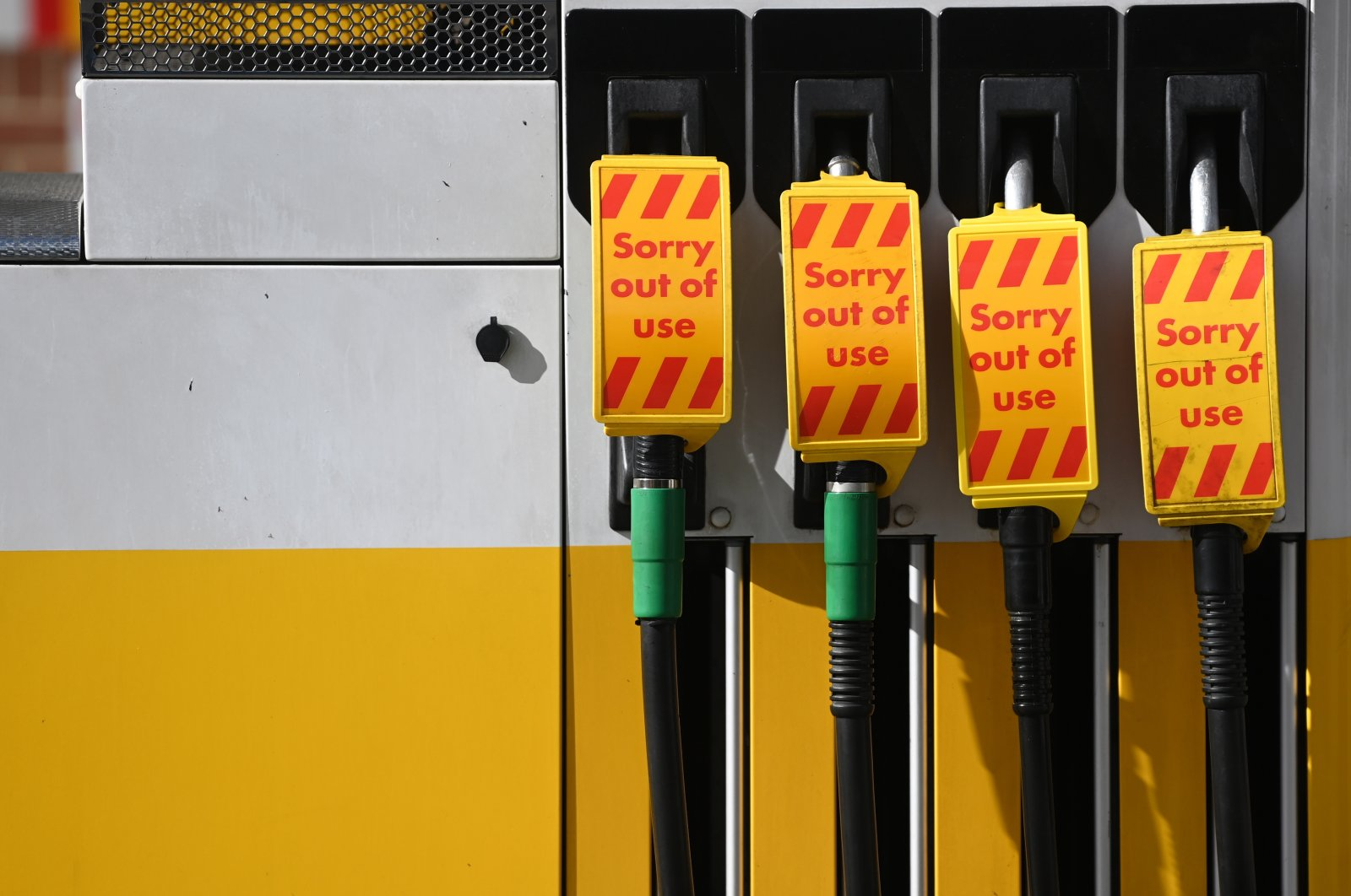 Out of use signs are displayed on fuel pumps in a Shell garage in Muswell Hill in London, Britain, Sept. 27, 2021. (EPA Photo)
