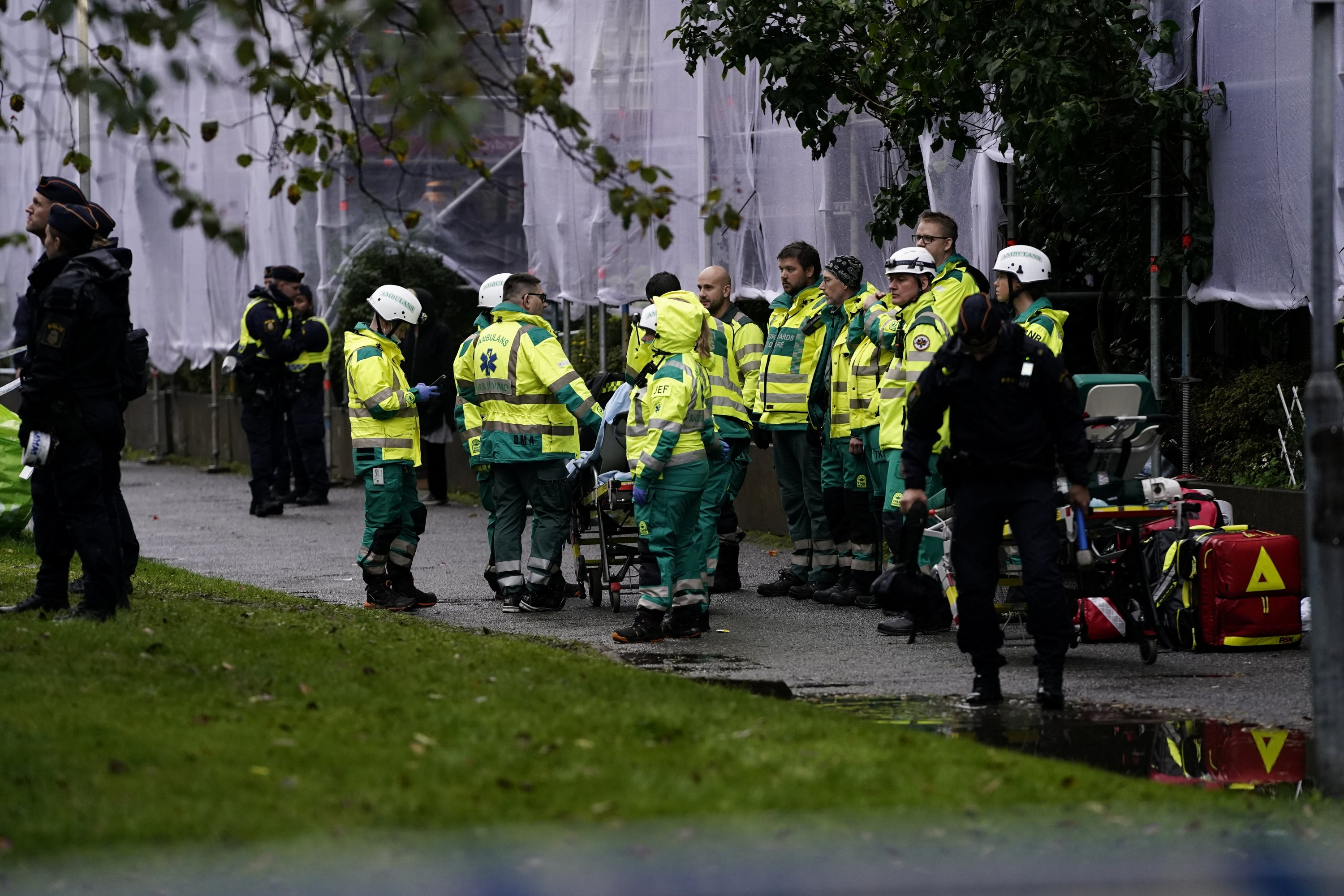 An emergency services crew works to evacuate people and put out a fire after an explosion hit an apartment building in Annedal, central Gothenburg, Sweden, Sept. 28, 2021. (Reuters Photo)