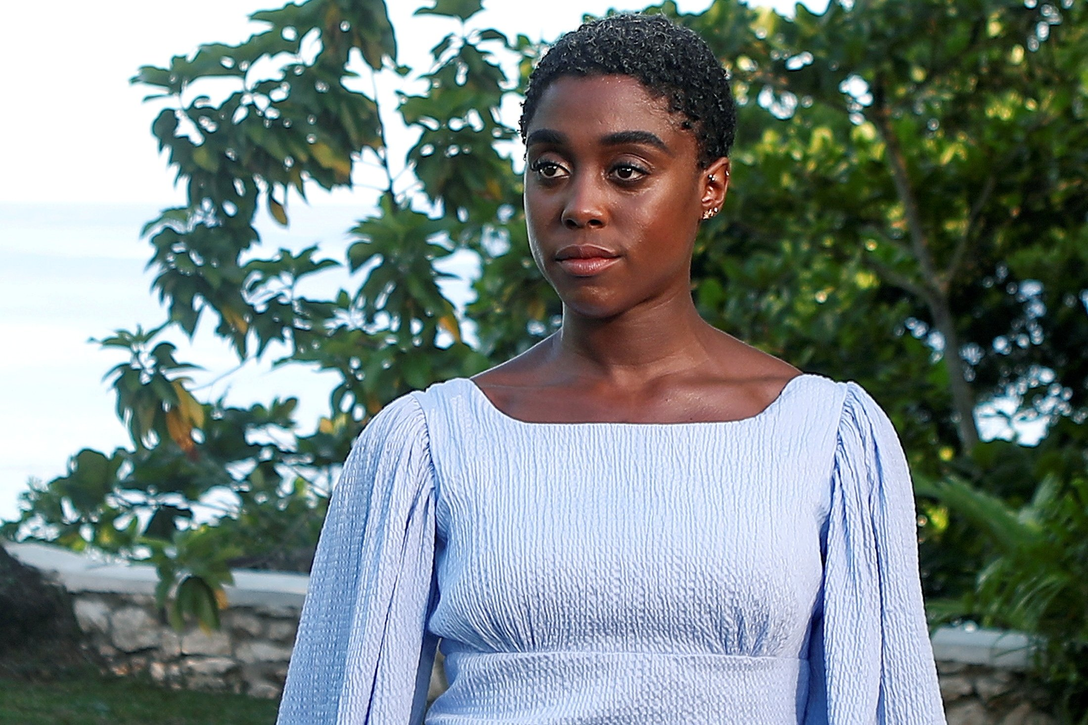 Actor Lashana Lynch poses for a picture during a photocall for the British spy franchise, James Bond's 25th film 'No Time To Die,' in Oracabessa, Jamaica, April 25, 2019. (Reuters Photo)