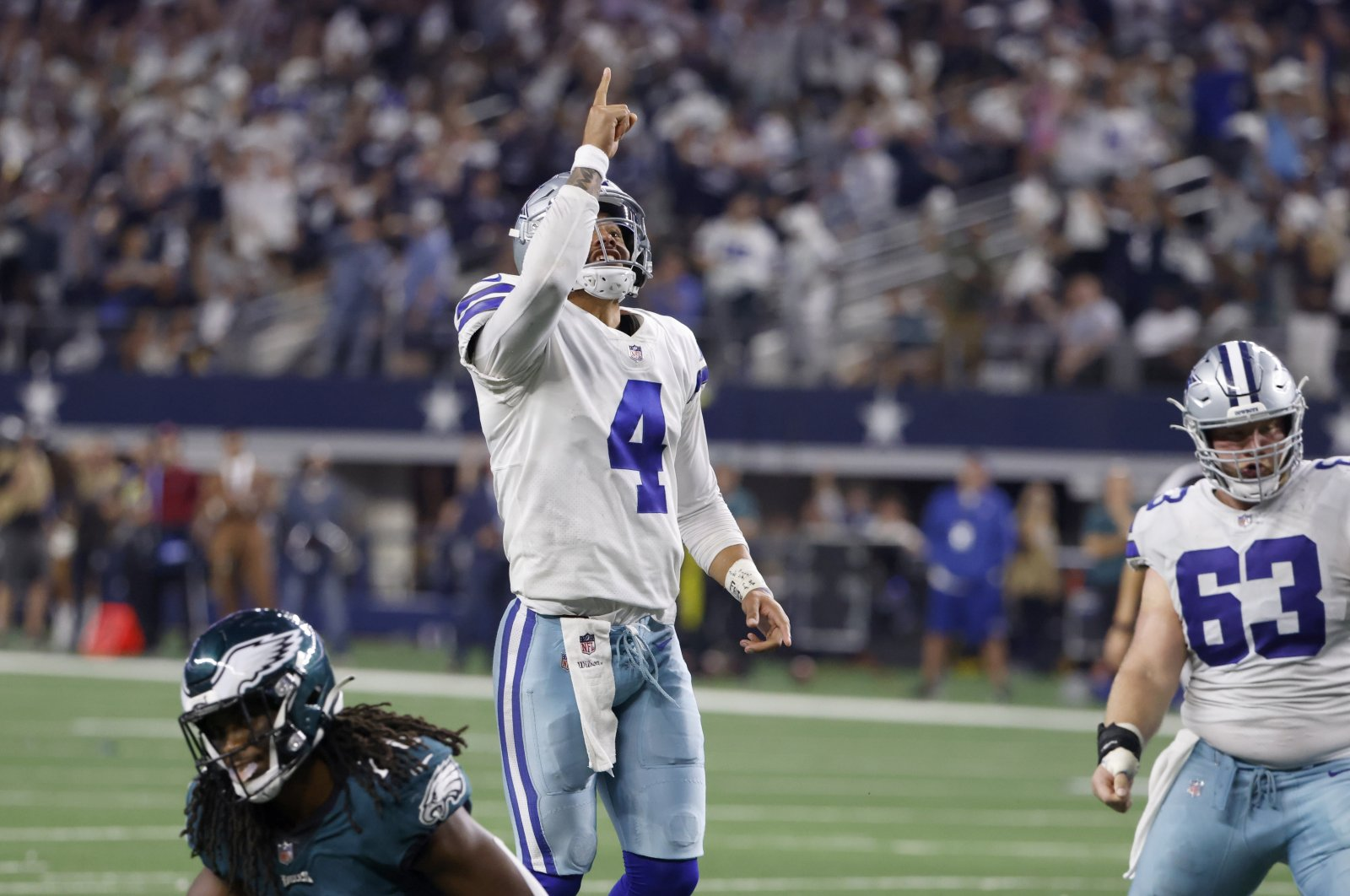 Dallas Cowboys quarterback Dak Prescott (4) and center Tyler Biadasz (63) celebrate a touchdown scored by Dalton Schultz in the second half of an NFL football game against the Philadelphia Eagles in Arlington, Texas, U.S., Monday, Sept. 27, 2021. (AP Photo)