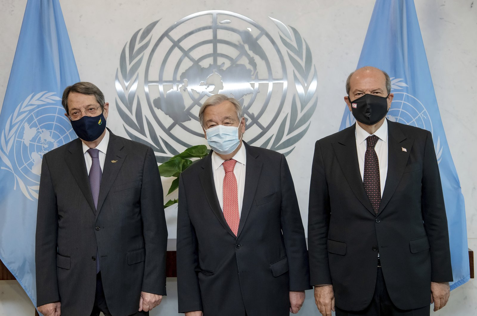 In this photo provided by the United Nations, Secretary-General Antonio Guterres (C) meets Greek Cypriot administration leader Nicos Anastasiades (L) and TRNC President Ersin Tatar, at U.N. headquarters, Monday, Sept. 27, 2021. (Mark Garten/U.N. via AP)