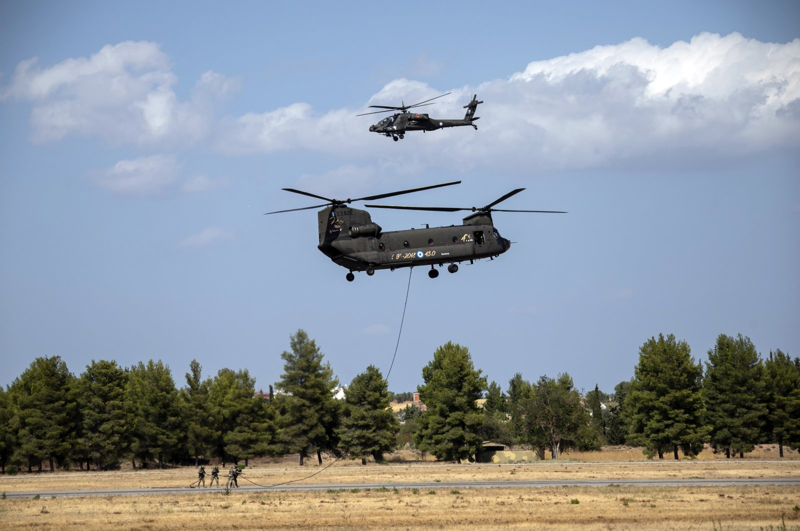 Greek military special forces perform with a CH-47 and a Kiowa helicopters during an airshow at Tanagra air base, north of Athens, Greece, Sept. 4, 2021. (AP Photo)