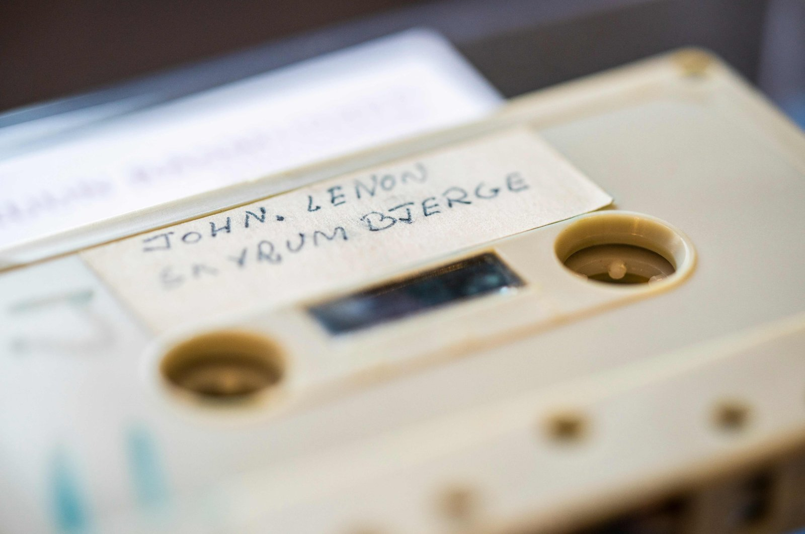 A cassette with the recording of four Danish schoolboys' interview with John Lennon and Yoko Ono is photographed at Bruun Rasmussen Auction House in Copenhagen, Denmark, Sept. 24, 2021. (AFP Photo)