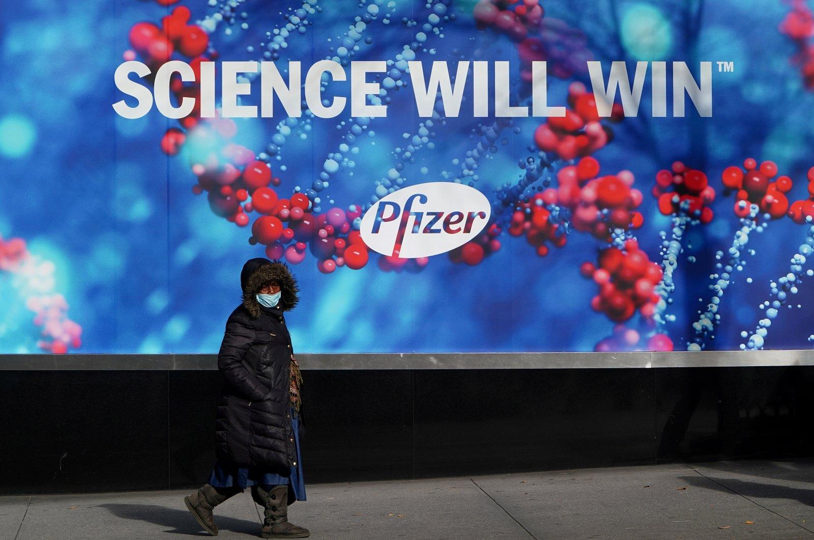 A person walks past the Pfizer Headquarters building in the Manhattan borough of New York City, New York, U.S., Dec. 7, 2020. (Reuters Photo)