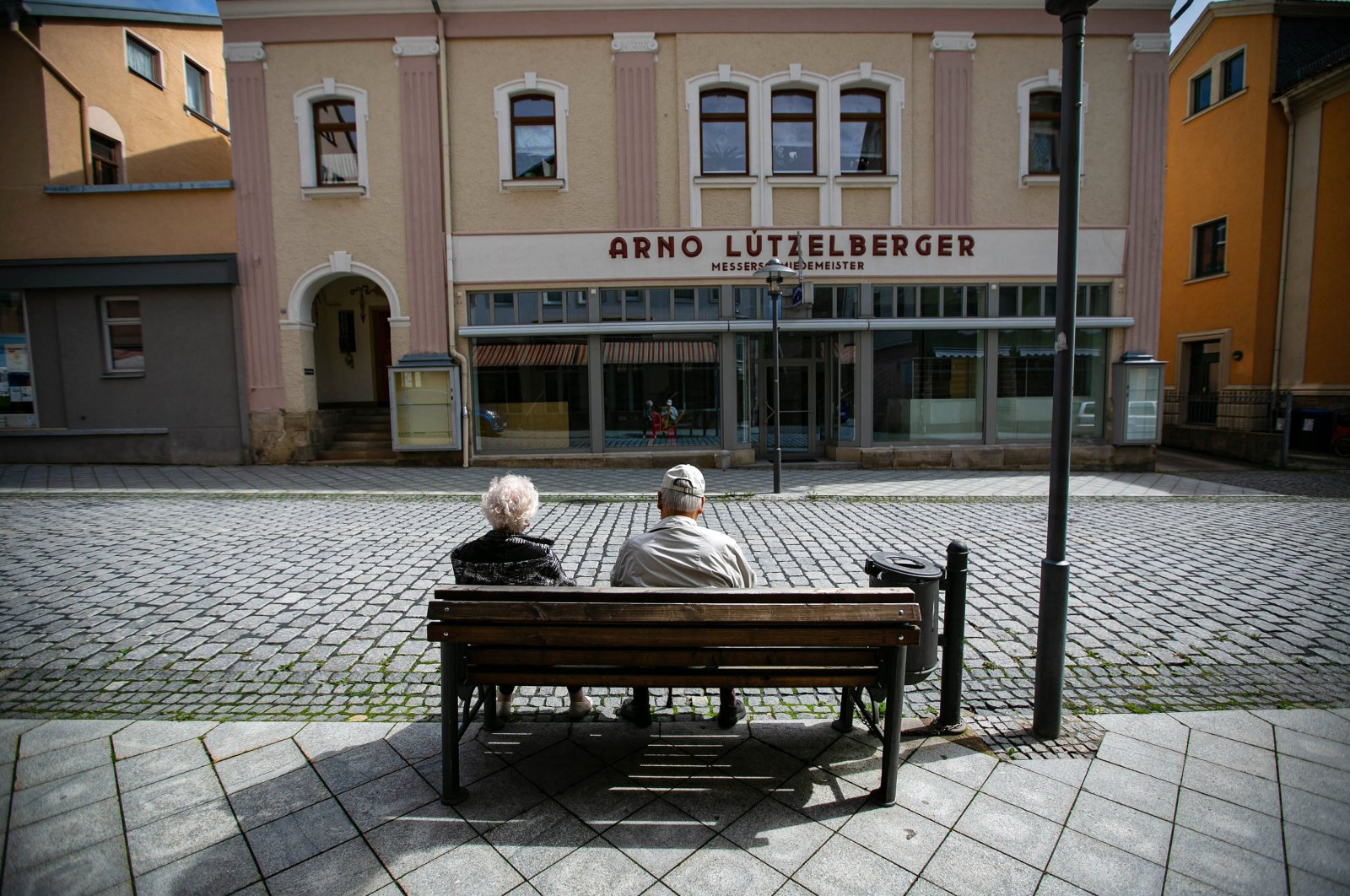 Pensioners rest on a bench in an empty street in Sonneberg, Germany, Aug. 30, 2021. (Getty Images)