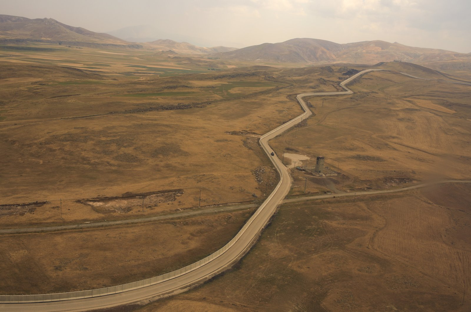 A wall that separates Turkey and Iran is seen in Van province, eastern Turkey, Aug. 21, 2021. (AP Photo)