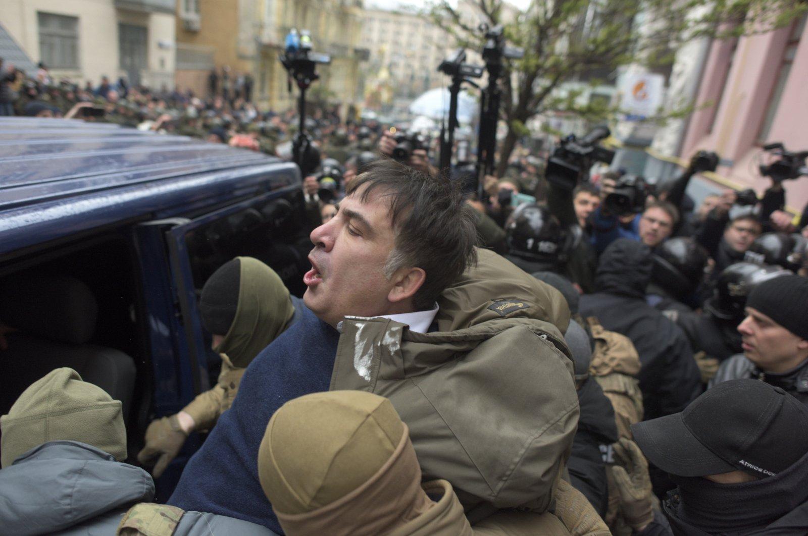 Ukrainian Security Service officers detain Mikheil Saakashvili at his house in Kyiv, Ukraine, Dec. 5, 2017. (AP Photo)
