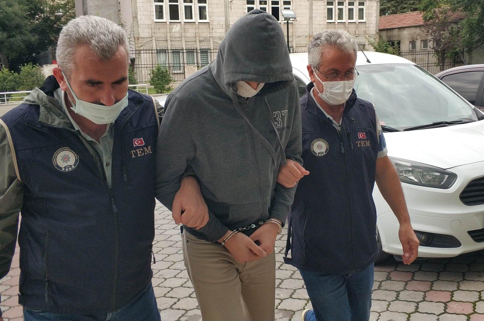 Police escort a FETÖ suspect to a courthouse, in western Denizli province, Turkey, Sept. 24, 2021. (İHA Photo)