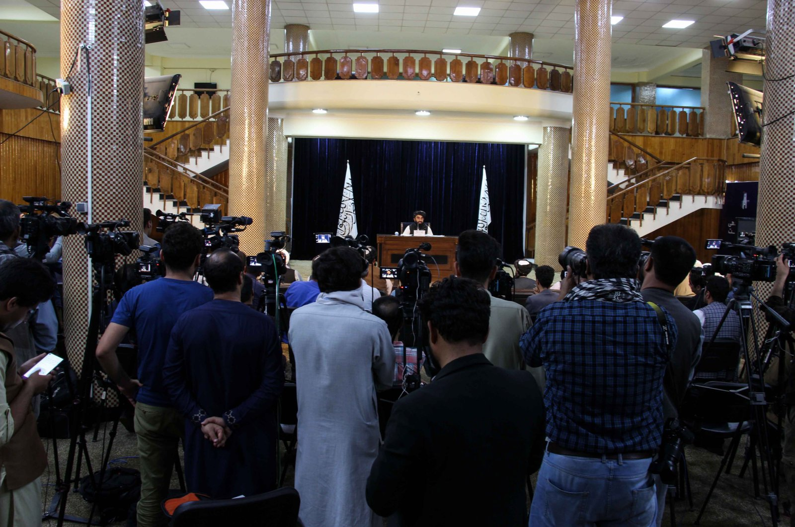 Zabhiullah Mujahid, the Taliban spokesperson, talks with journalists as he announces the interim government during a press conference in Kabul, Afghanistan, Sept. 7, 2021. (EPA Photo)