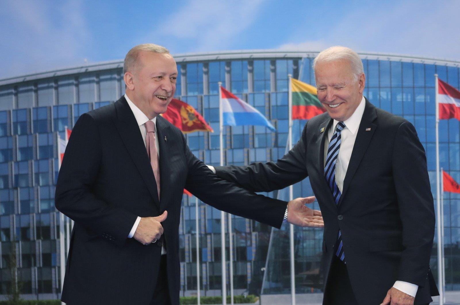 President Recep Tayyip Erdoğan and his U.S. counterpart Joe Biden gesture during their meeting at the NATO headquarters in Brussels, Belgium, June 14, 2021. (DHA Photo)