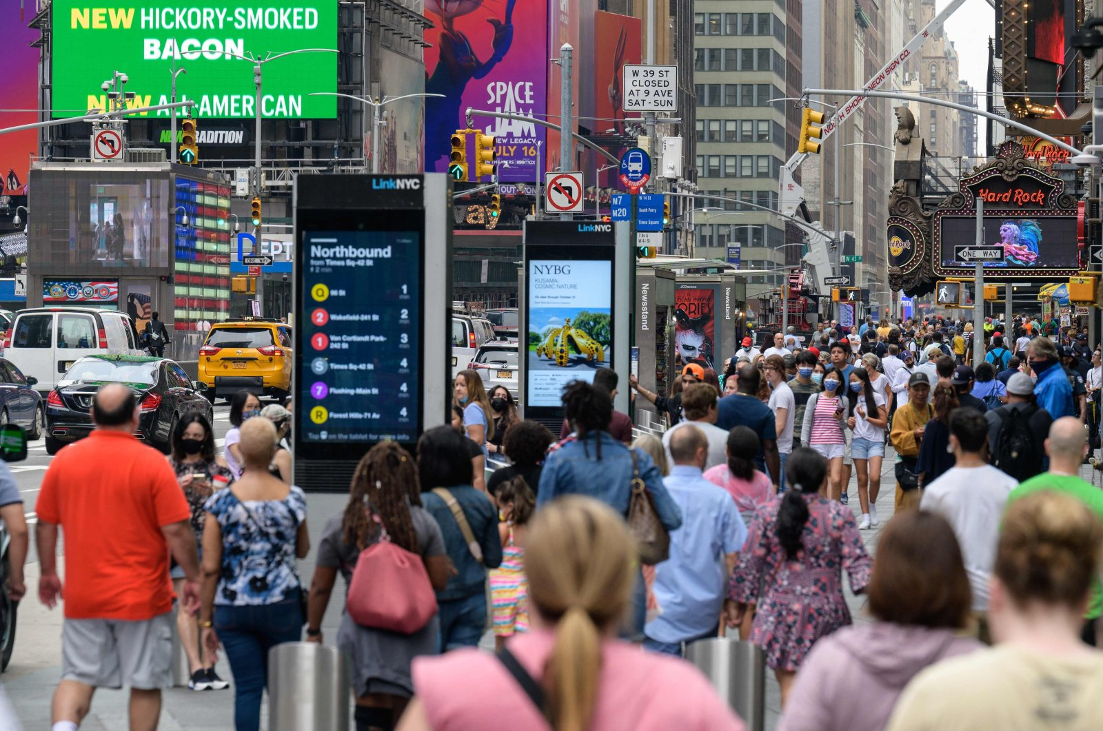 In this file photo, people walk through Times Square in New York City, U.S., July 13, 2021. (AFP Photo)