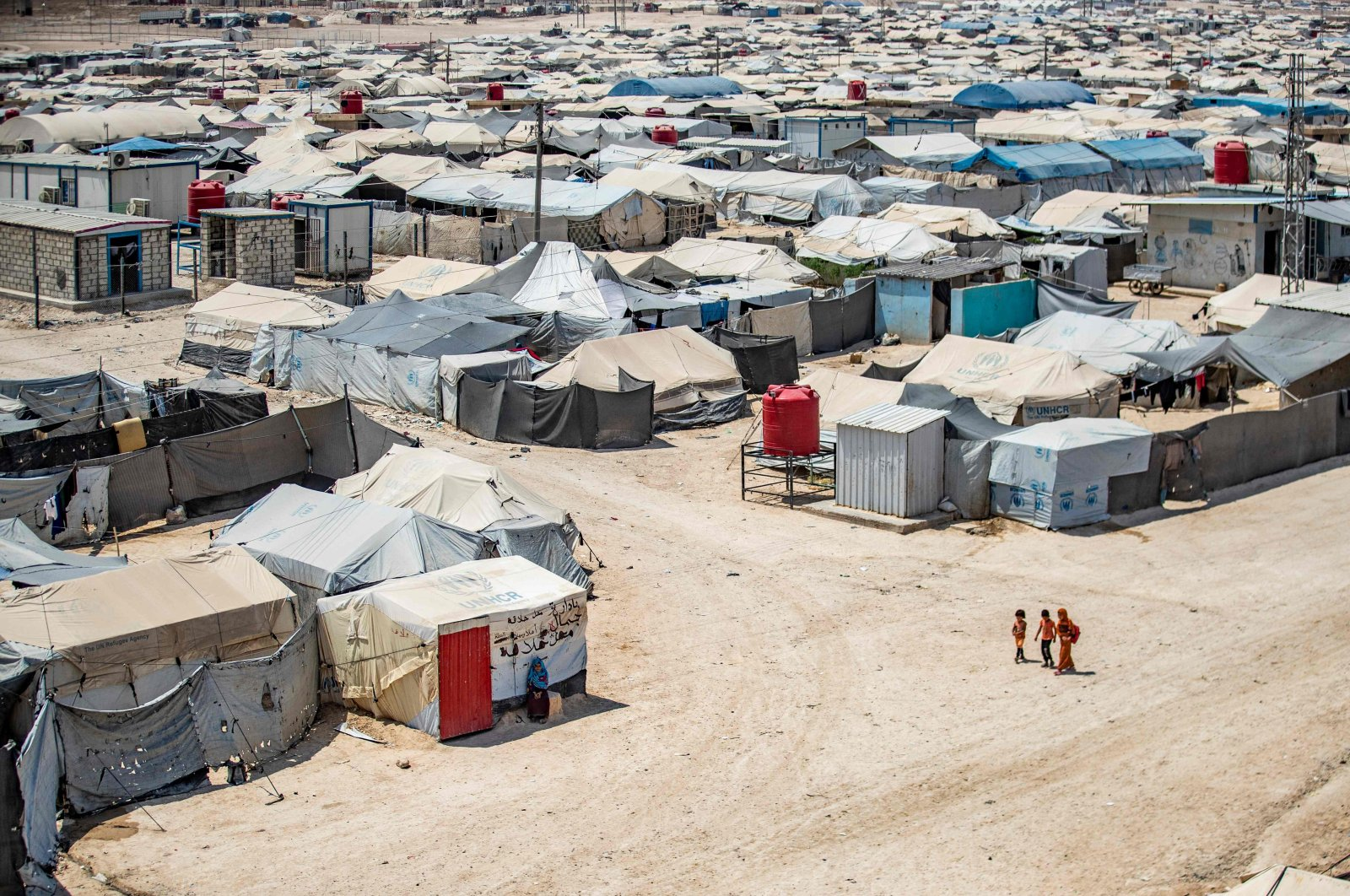 Children walking among shelters at the al-Hol camp, in Syria's northeastern Hassakeh governorate, Aug. 2, 2021. (AFP Photo)