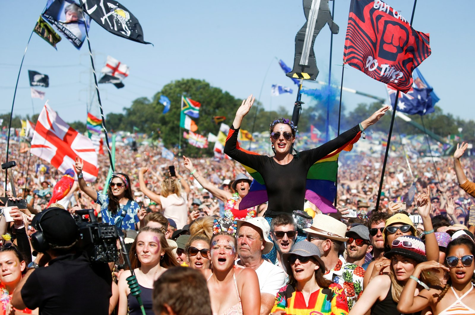 Revellers watch Kylie Minogue perform on the Pyramid Stage during the Glastonbury Festival in Somerset, England, U.K., June 30, 2019. (Reuters Photo)