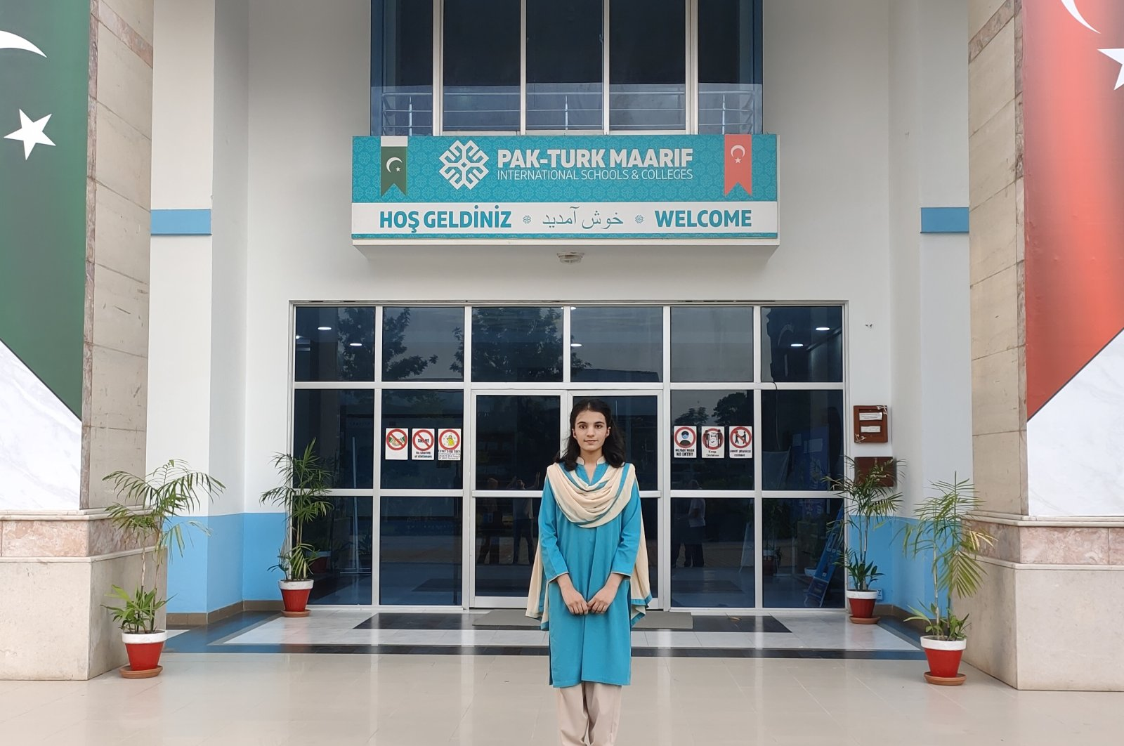 Pakistani student Moiza Zahid poses in front of a Pak-Türk Maarif International School in Islamabad, Pakistan, Sept. 28, 2021. (AA Photo)