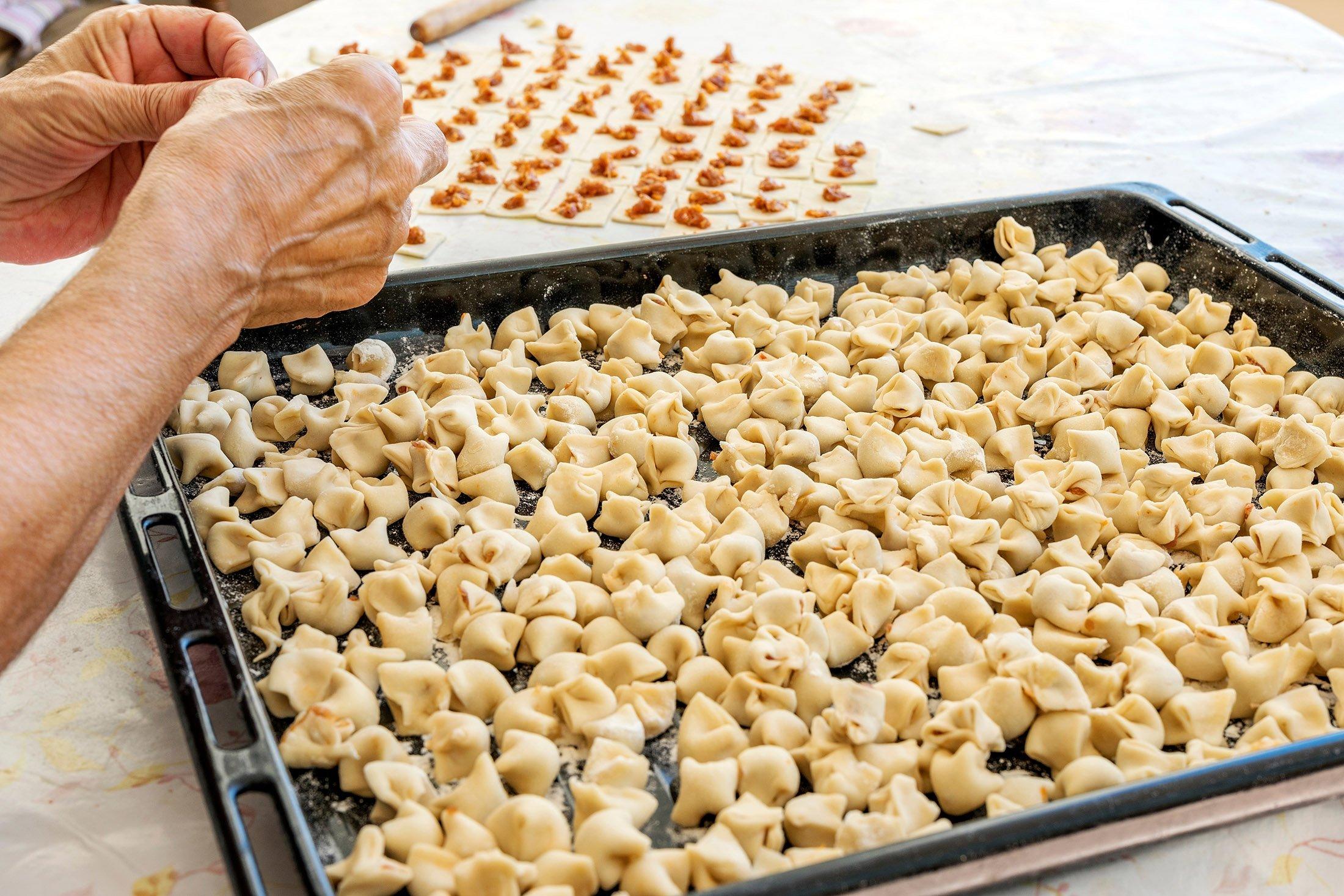 A woman makes Turkish mantı. (Shutterstock Photo)