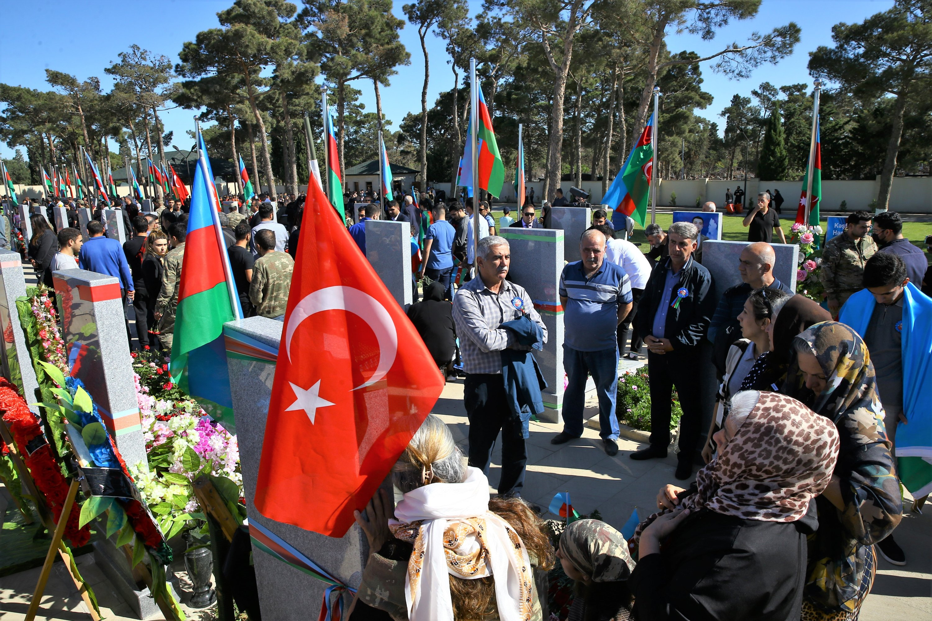 A Turkish flag between Azerbaijani flags is seen during the march in memory of the fallen soldiers of the 44-day war started on Sept. 27, 2020 for the liberation of the lands occupied by Armenia in Baku, Azerbaijan, Sept. 27, 2021. (AA Photo)