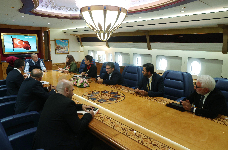 President Recep Tayyip Erdoğan speaks with reporters on his return flight from Sochi, Russia, Sept. 30, 2021. (Handout Photo)
