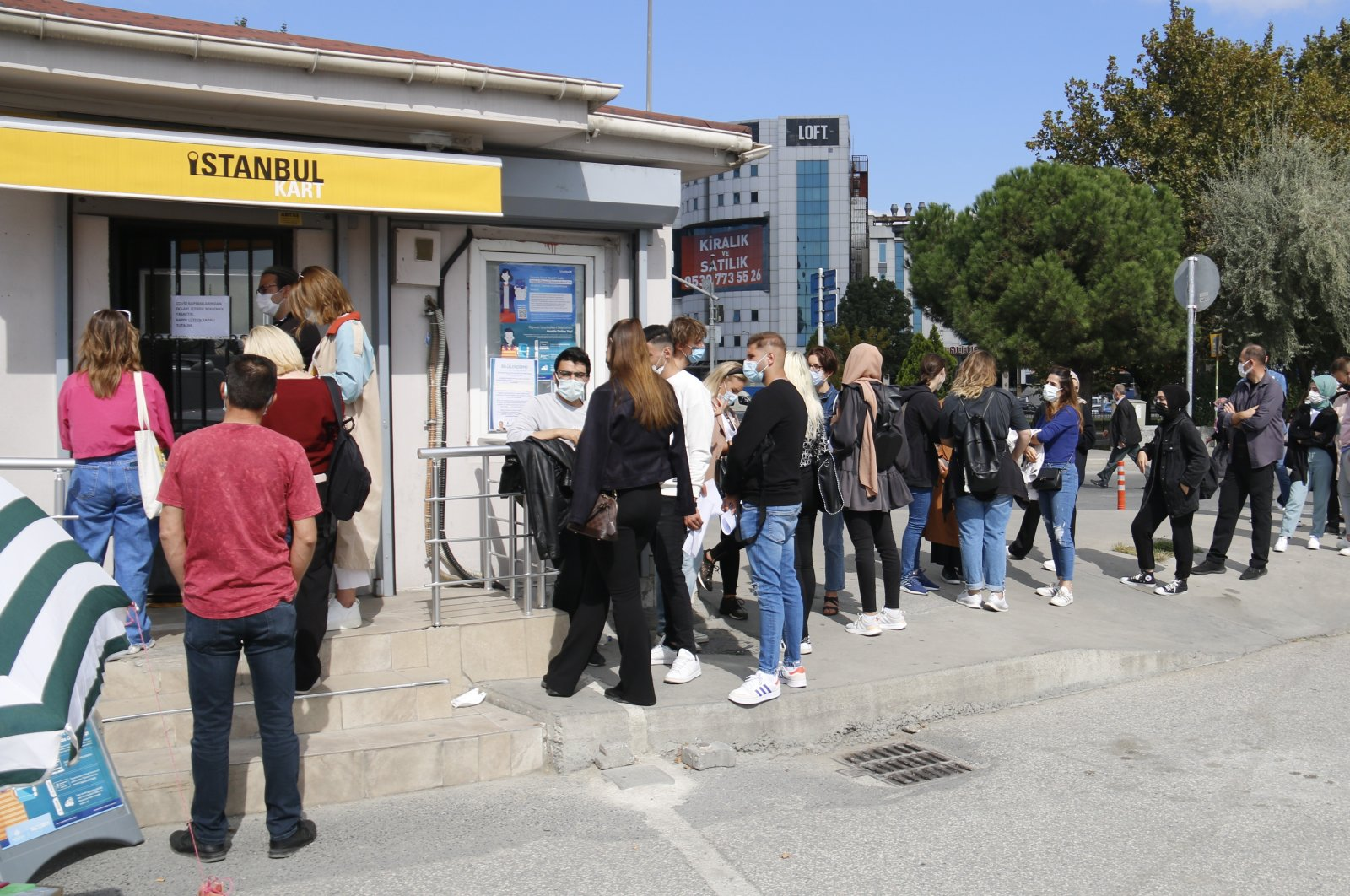 People waiting outside an Istanbulkart sales point, in Istanbul, Turkey, Sept. 29, 2021. (İHA PHOTO)