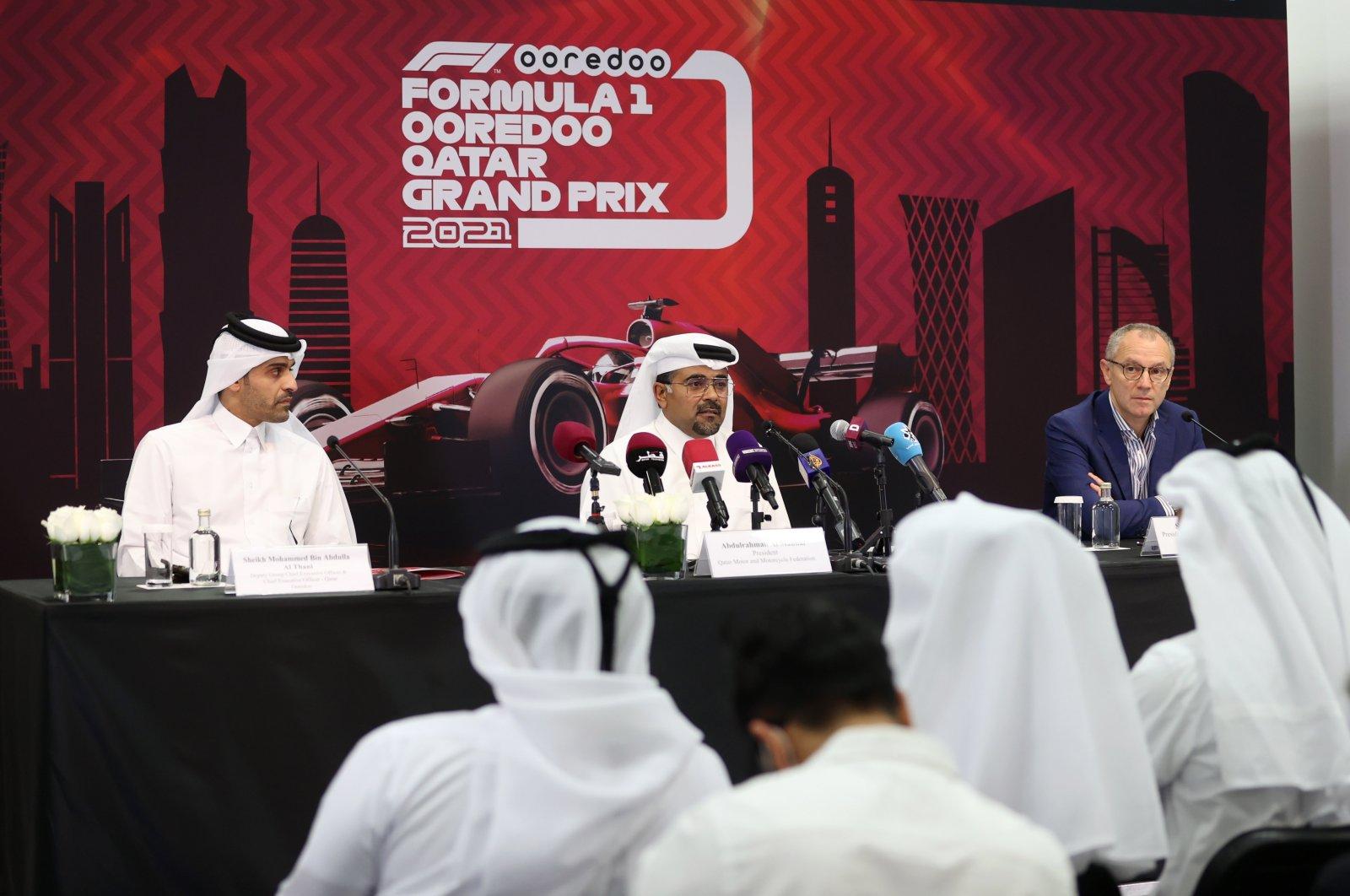 Qatar Ooredoo CEO Sheikh Mohammed bin Abdulla Al Thani (L), Qatar Motor and Motorcycle Federation President Abdulrahman al Mannai (C) and Formula One Group CEO StefanoDomenicali (R) announce the first-ever Qatar Grand Prix at a press conference in Doha, Qatar, Sept. 30, 2021. (Reuters Photo)