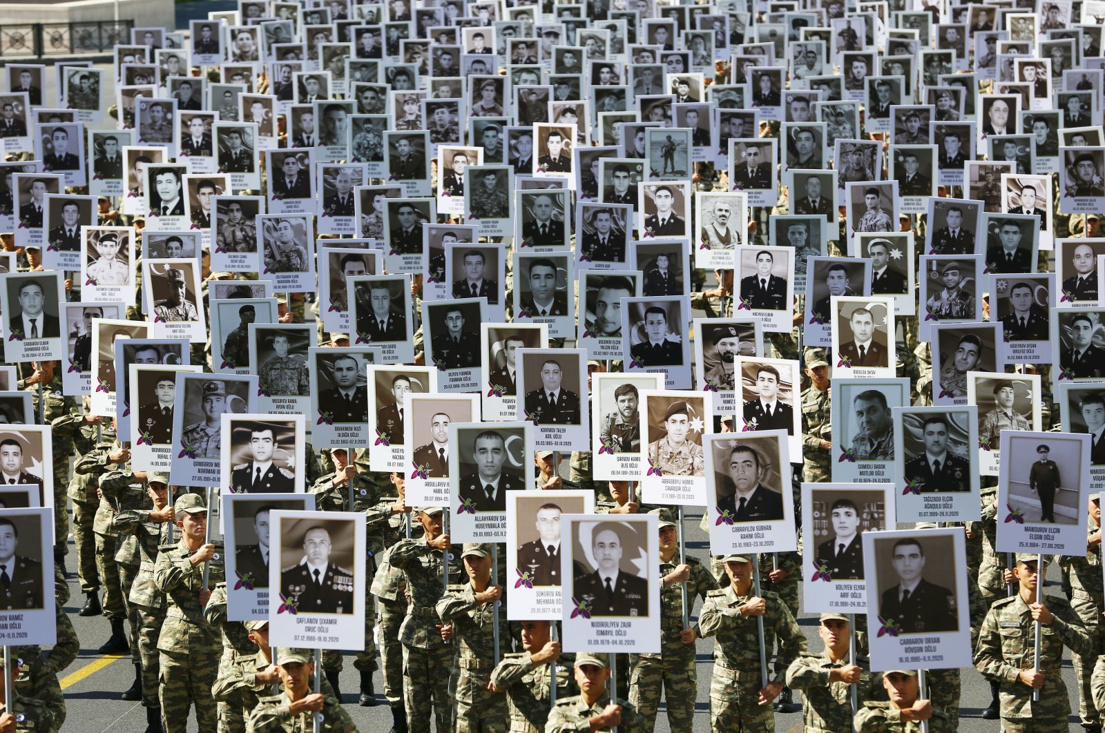 On the first year anniversary of the 44-day war started on Sept. 27, 2020 for the liberation of the lands occupied by Armenia, a march was held in Azerbaijan in memory of the fallen soldiers in Baku, Azerbaijan, Sept. 27, 2021. (AA Photo)