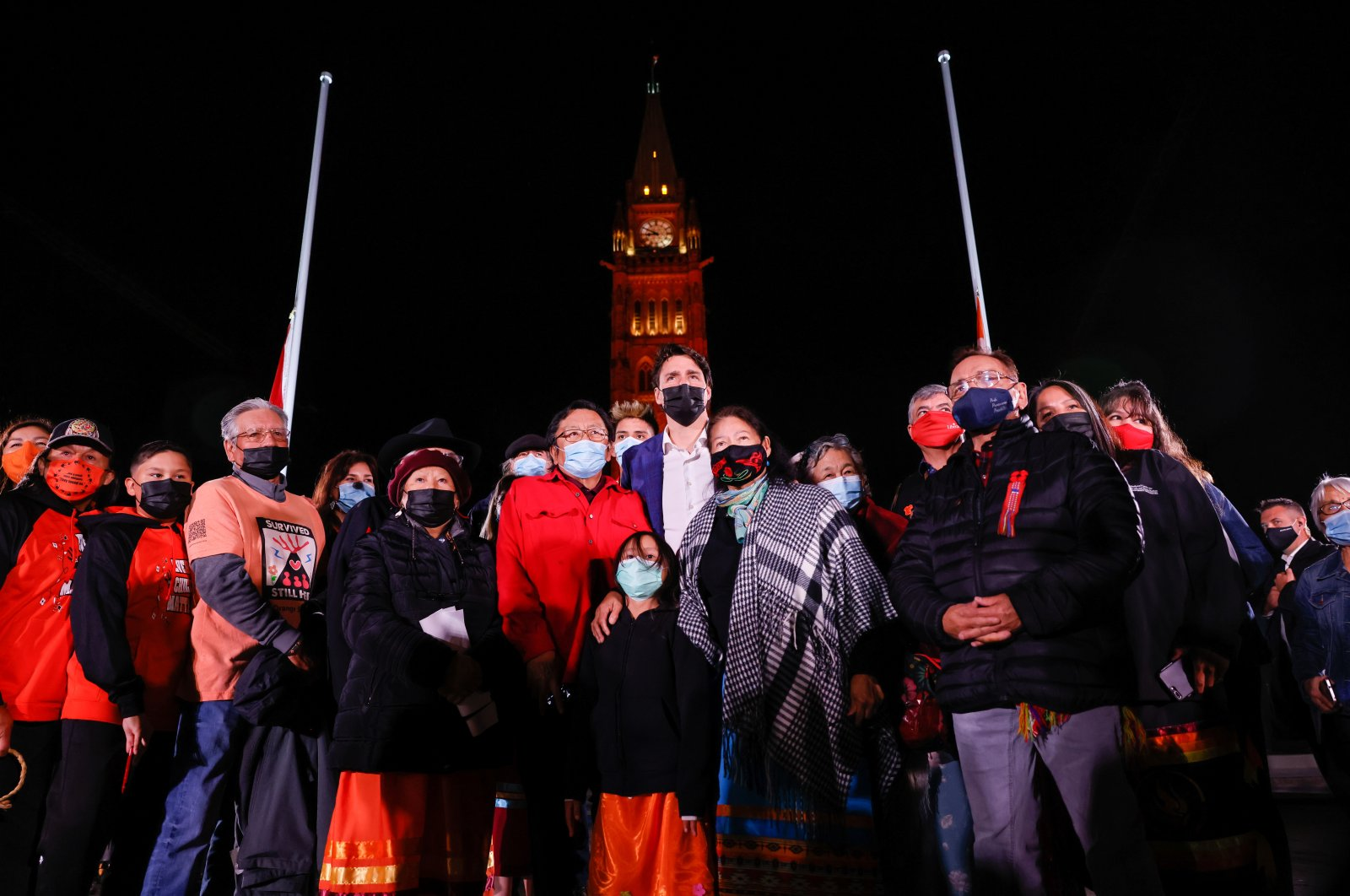Canadian Prime Minister Justin Trudeau poses for a group photo with survivors and family members, on the eve of Canada's first National Day for Truth and Reconciliation, honoring the lost children and survivors of Indigenous residential schools, their families and communities on Parliament Hill in Ottawa, Ontario, Canada Sept. 29, 2021. (Reuters Photo)