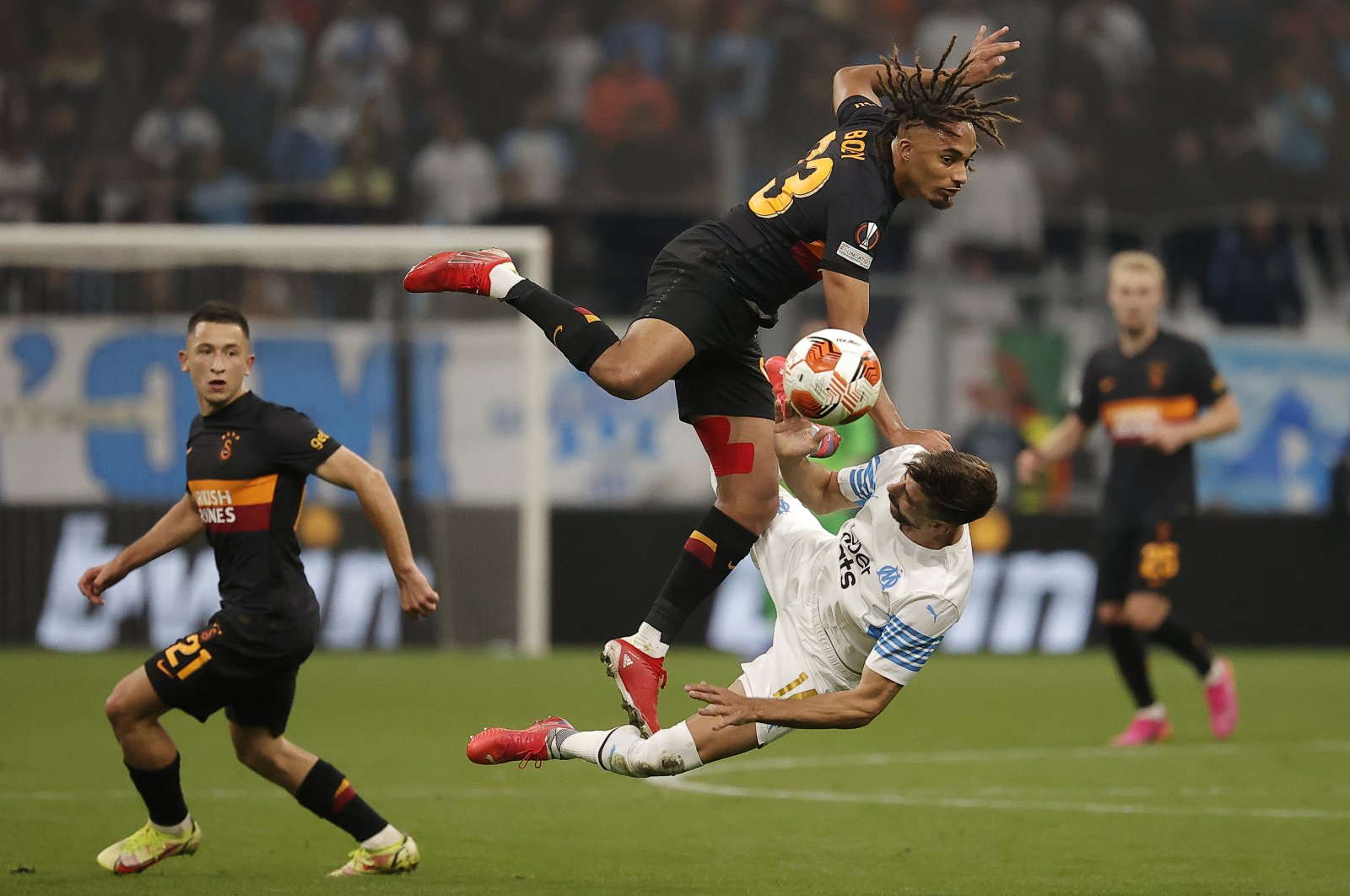 Galatasaray's Sacha Boey in action with Marseille's Luan Peres during the UEFA Europa League match, Marseille, France, Sept. 30, 2021 (AA Photo)