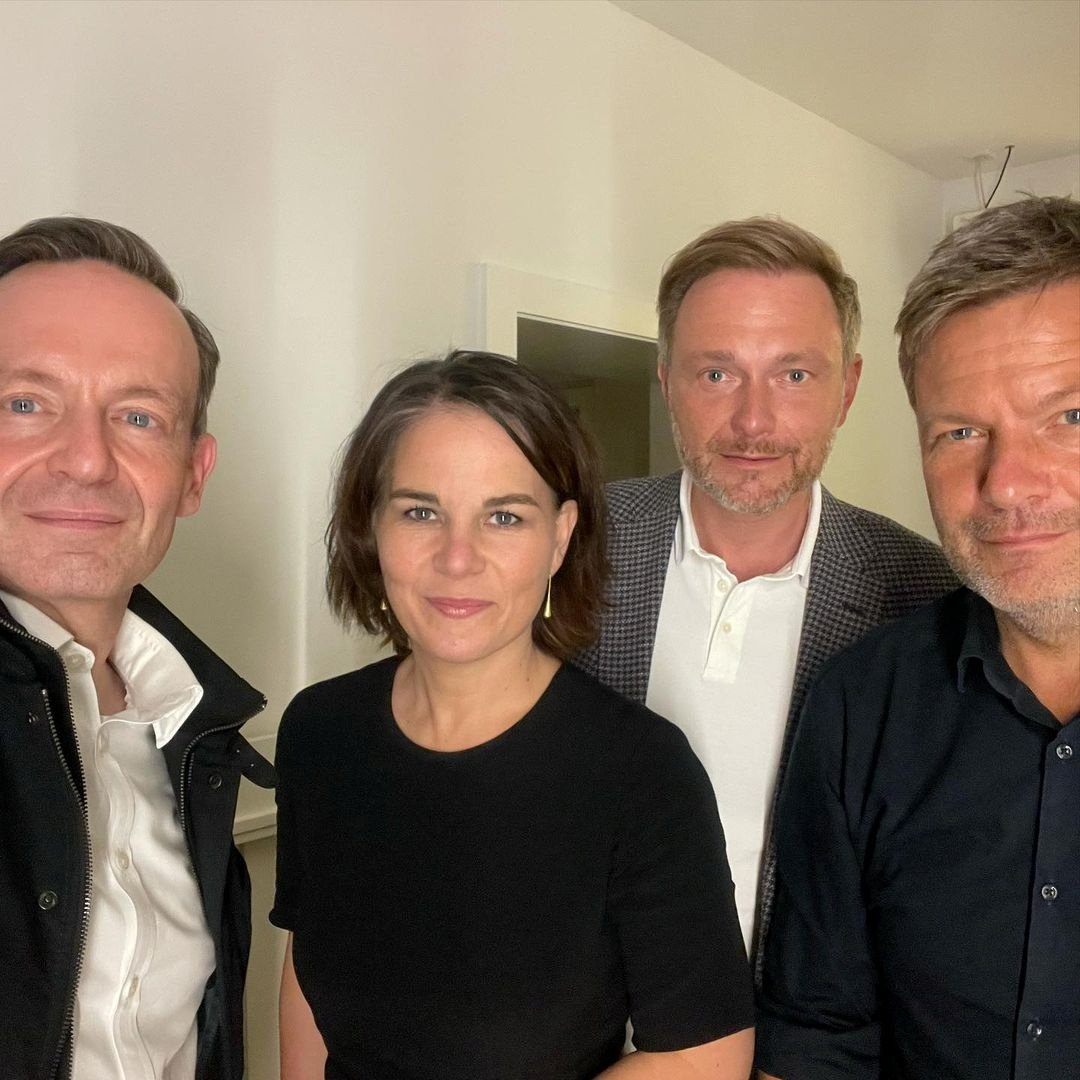 German politicians Volker Wissing (L) and Christian Lindner (R) of the FDP, together with Annalena Baerbock (C-L) and Robert Habeck of the Greens, pose for a selfie photograph, in an unknown location on Sept. 28, 2021, in this picture obtained from social media. (INSTAGRAM @volkerwissing via Reuters)