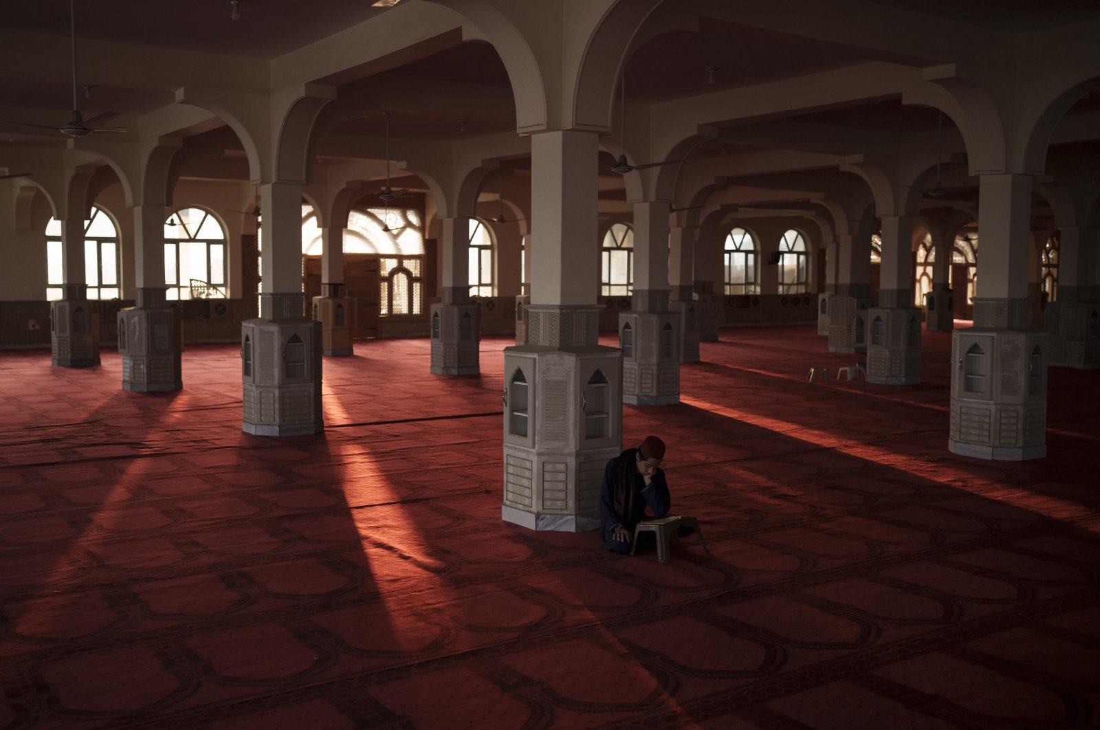 An Afghan student reads the Quran at the mosque of the Khatamul Anbiya madrasa in Kabul, Afghanistan, Sept. 29, 2021. (AP Photo)