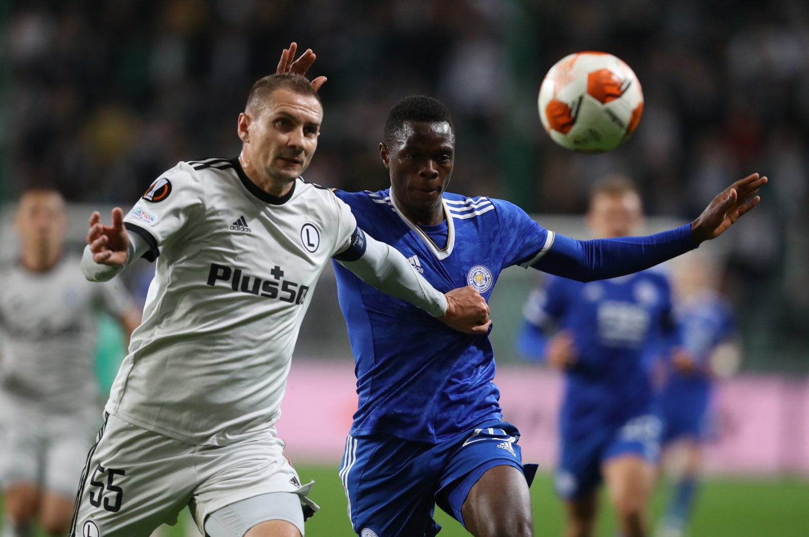 Legia Warsaw's Artur Jedrzejczyk in action with Leicester City's Patson Daka during a Europa League match in Warsaw, Poland, Sept. 30, 2021. (Reuters Photo)