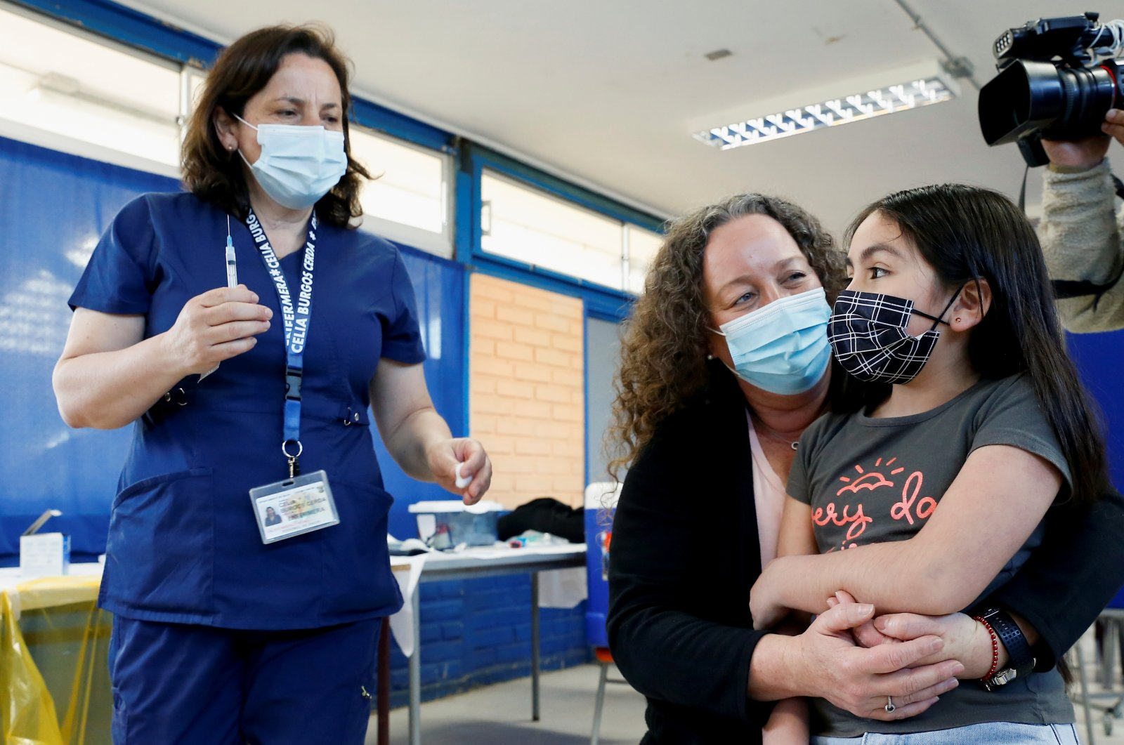 A girl prepares to receive a dose of the Sinovac vaccine against the coronavirus disease (COVID-19) at a public school in Concon, Chile  Sep. 27, 2021. (Reuters Photo)