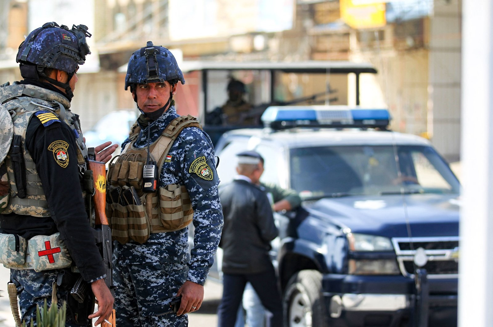 Members of the Iraqi federal police forces stand guard at a checkpoint in a street in the capital Baghdad, Jan. 29, 2021,  (AFP Photo)